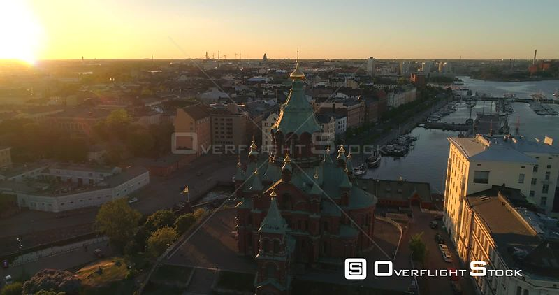 Helsinki Orthodox Church, Aerial Tilt View Away Uspetski Cathedral and Its Golden Cupole, in the City, on a Sunny Summer Evening Dusk, in Helsingfors, Uusimaa, Finland