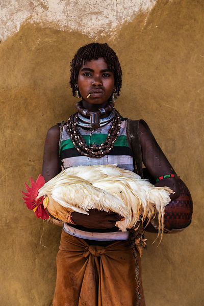 Portrait of a Hamar Girl Holding a Chicken