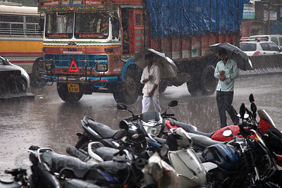 Monsoon rains on a main thoroughfare through Dharavi, Mumbai, India.