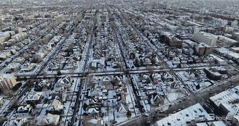 Aerial Above Snowy Rooftops of Brooklyn Brownstones and Streets Winter NYC