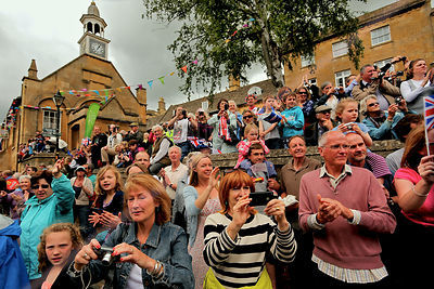 Jubilant Spectators at Olympic Torch Relay Event