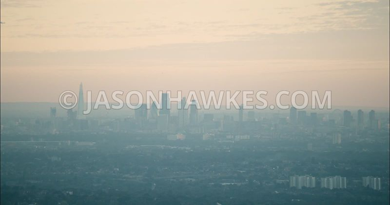 London Aerial Footage of City of London skyline at sunset.
