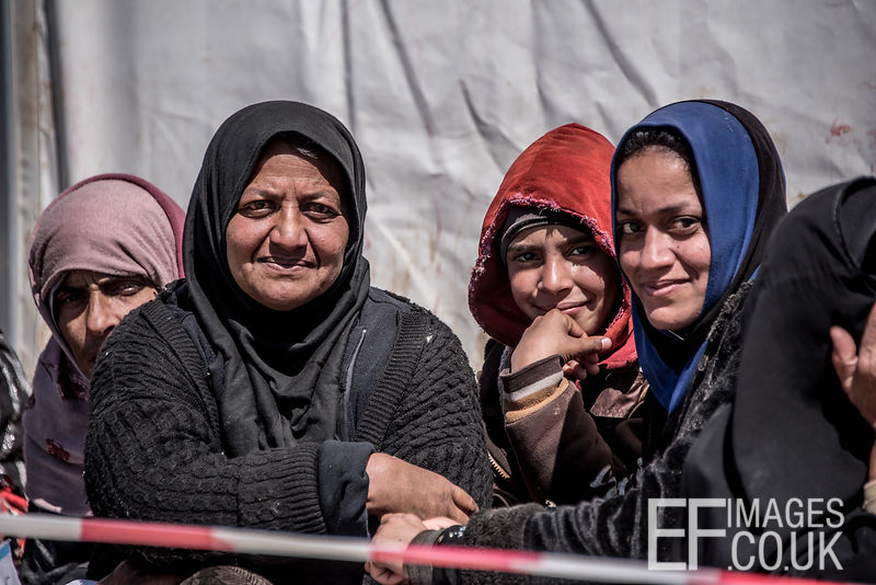 Having Escaped Mosul Earlier In The Day, This Family Say They Are Relieved To Be Alive. Queuing In The Sun For Hours For Food Doesn't Seem So Bad Compared With The Life They Have Had Under ISIS In Mosul