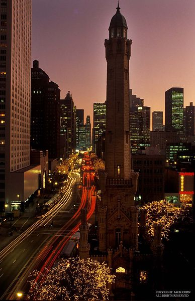 Chicago, water tower in foreground at dusk