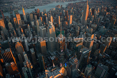 Aerial view looking across Midtown Manhattan, showing the Empire State Building, the Chrysler Building and the Bank of America Tower