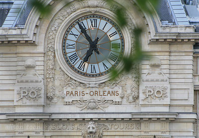 Clock on wall, Paris, France