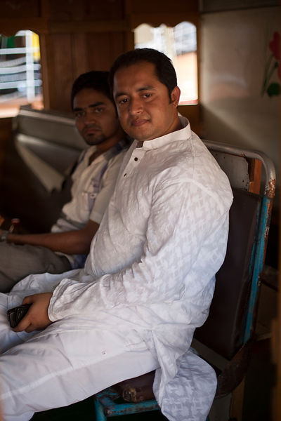 Bangladesh - Dhaka - Two friends on a ferry on the Buriganga River at Sadarghat