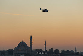 Süleymaniye Mosque with an airplane in Istanbul.