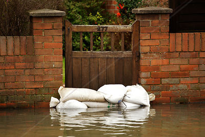 Sandbags Stacked against Garden Gate Keeping out Water