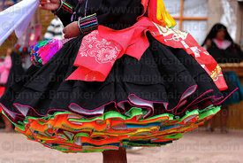 Detail of pollera of female Suri Sikuri dancer at San Santiago festival , Taquile Island , Peru