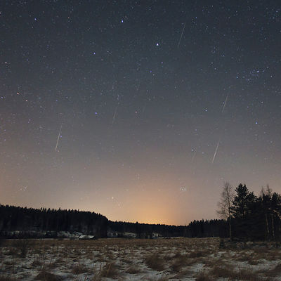 Eight Quadrantid meteors can be seen above the countryside landscape in this image taken between 04:58 - 05:17 am, during the peak of the meteor shower on January 4 2016.