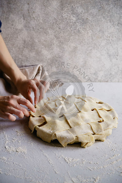 Uncooked apple pie with a wide lattice