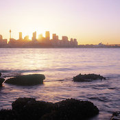 Sydney skyline at dusk from Bradleys Head in Sydney Harbor National Park, Mosman, New South Wales, Australia