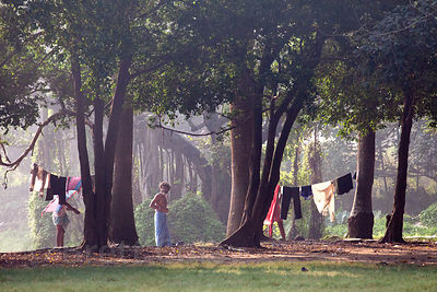 Men bathe at a small lake on the Maidan, a large park in central Kolkata, India.