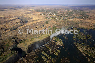 Victoria Falls (Mosi-oa-Tunya) from the air, showing the zig-zagging gorges south of the Victoria Falls Bridge and Victoria Falls town, Zimbabwe