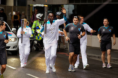 Paralympic Torch Bearer in Lambeth Waving