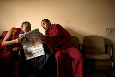 India - Sarnath - Buddhist monks reading a newspaper