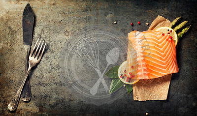 Raw salmon fillet and ingredients for cooking in a rustic style. Top view