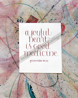 A joyful heart is good medicine… - Proverbs 17:22 - in hand lettered calligraphy and hand drawn art - IWC Item:   1123P