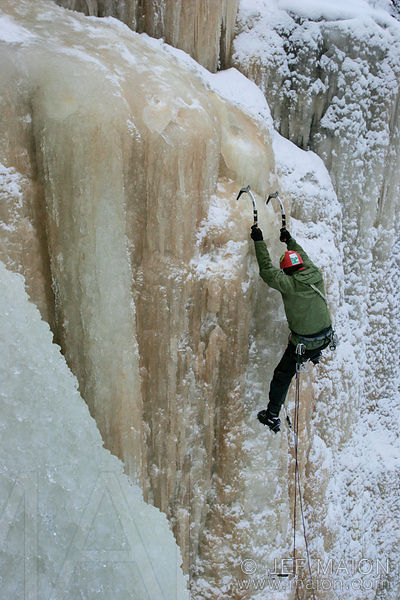 Ice climber on brown icefall