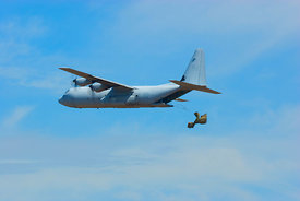 RAAF Hercules doing a pallet drop