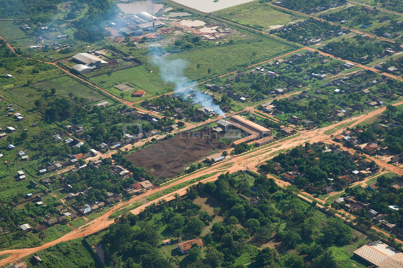 Aerial view of Brazil nut (Bertholletia excelsa) processing plant with large piles of nut shell residue, Riberalta town, Beni Department, Northeastern Bolivia.