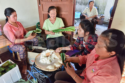 Women preparing sticky rice, Laos photos