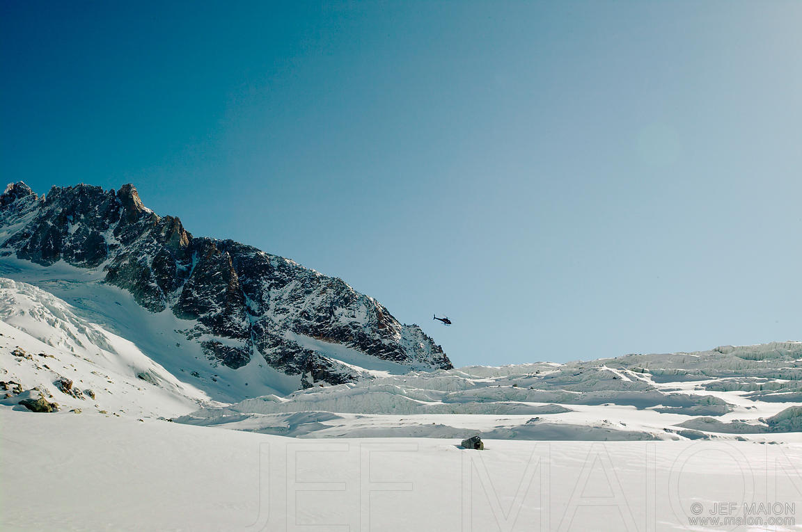 Helicopter above glacier