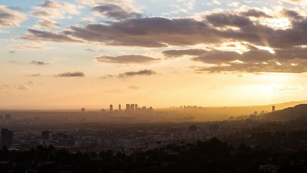Bird's Eye: Endless Nimbostratus Clouds Framing A Golden Sunset Over All Of L.A.