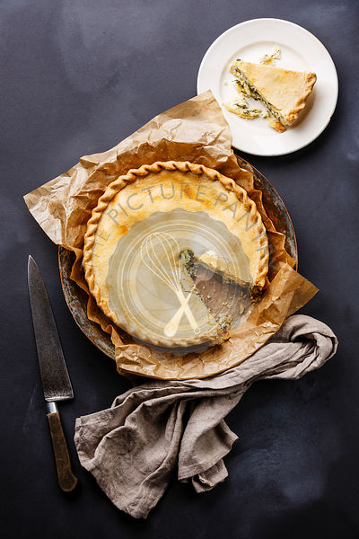 Cheese Pie with herbs on dark background