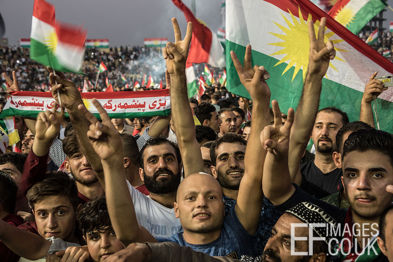 Attendees at the final Kurdish Independence Referendum rally, held at the Franso Hariri Stadium in Erbil, wave flags and raise banners in support of an Independent State. 22nd September 2017. Elizabeth Fitt