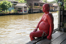A sculpture of an underware man at Khlong Bang Luang artist village on the west side of the Chao Phraya River in Thonburi, Bangkok, Thailand.