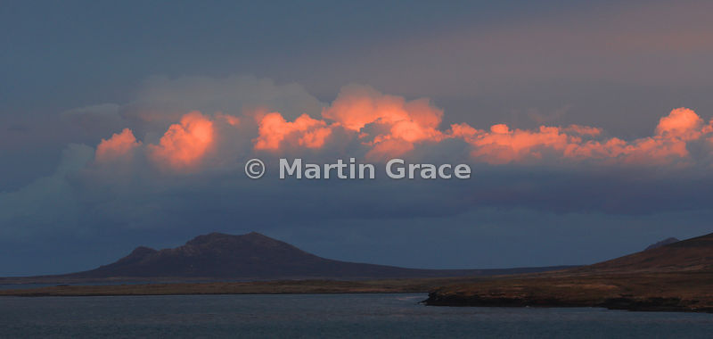 Sunset sky over Marble Mountain on Pebble Island from Saunders Island, Falkland Islands