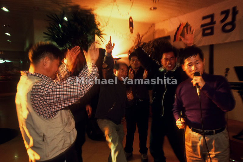 South Korean tourist in a karaoke contest aboard the Seobongho, North Korea.