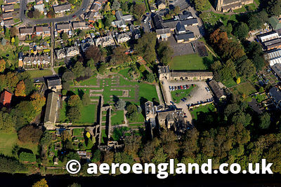 aerial photograph of Whalley Abbey Lancashire , a ruined Cistercian abbey closed in 1537 as part of the dissolution of the monasteries by Henry VIII