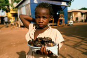 Ghana - Tamale - A street child selling food on the street