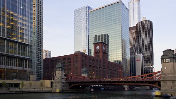 Medium Shot: Sunset Over Chicago River Bridge