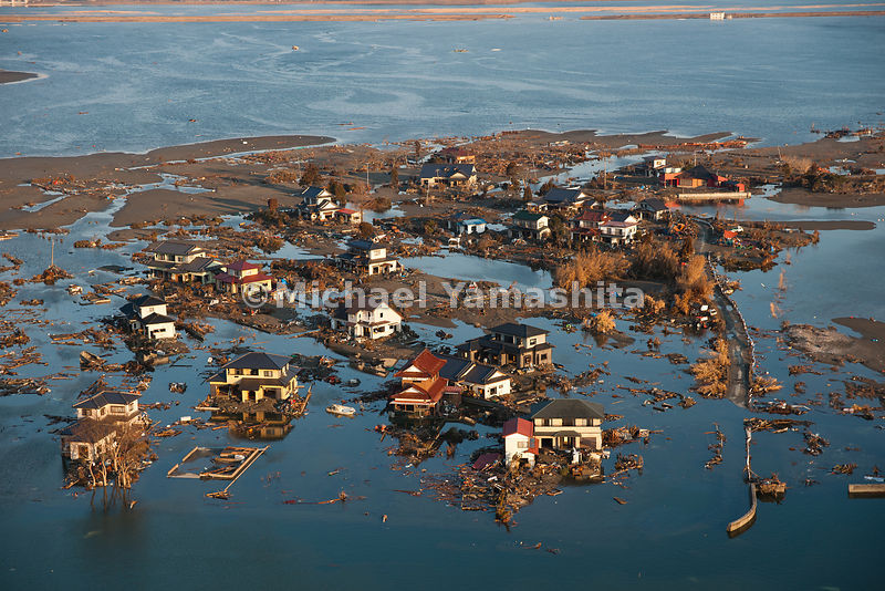 March 11 Great Eastern Japan Earthquake and Tsunami. Measuring 9, biggest ever to hit Japan destroying the NE coast line cities and villages for 200 plus miles. Aerials over Ishinomaki where land sunk during earthquake and water is left standing and people cannot yet go back to their houses.