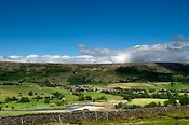 Village of Reeth in Swaledale, from Harkerside, with Fremington Edge in the background.