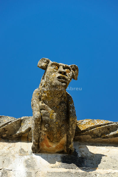 A stone gargoyle with the figure of a monster. Convent of Christ, a UNESCO World Heritage Site. Tomar, Portugal
