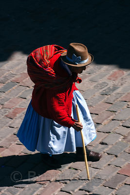 Elderly Inca woman walking with a cane, Cusco, Peru