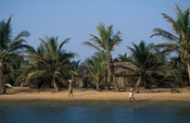 homesteads at the mouth of the Volta river, Volta estuary, Ada-Foah, Ghana