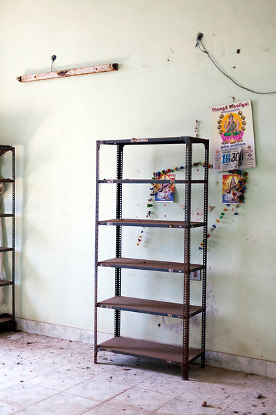 A room with shelving in the derelict Hotel du Ville that has been saved by INTACH (Indian National Trust for Art and Cultural Heritage). Pondicherry, India