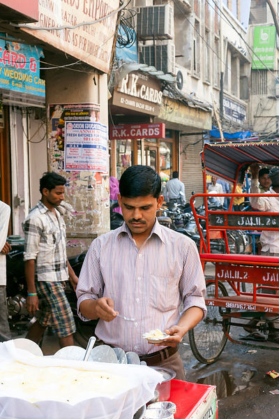 India - Delhi - A man sells daulat ki chaat on the streets