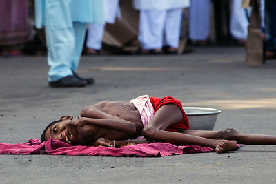 A Hindu boy with cerebral palsy begs during the Muslim Eid al-Adha festival, Red Road, Madian, Kolkata, India. I have the only photos taken by a foreigner of this most important day to Muslims at the most auspicious site in Kolkata for both 2012 and 2013.