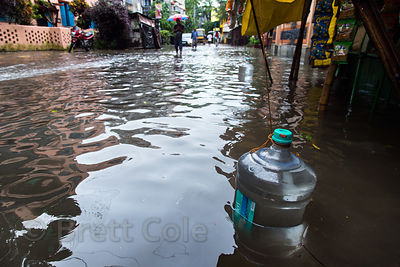 Water jug in monsoon flooding, Lake Gardens, Kolkata, India. Taken during the heaviest rains in Kolkata in a decade.