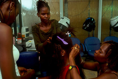 Angola - Luanda - A model has her hair done in an upmarket Luandan salon.