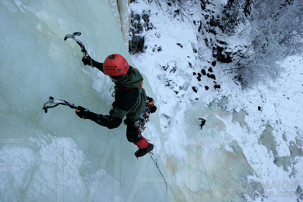 Ice climber high above the ground
