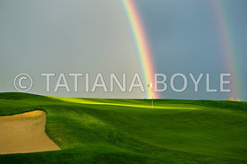 Golf putting green and double rainbow | Single-frame photograph
