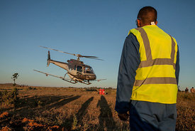 A helicopter of the Food and Agriculture Organization of the United Nations (FAO), equipped with pesticide spreading equipment to fight a swarm of locusts, takes off for his mission on May 7, 2014 in Tsiroanomandidy, Madagascar. FAO mission is to fight the locust's swarm with an insecticide.
